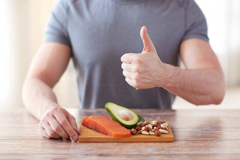 healthy eating, diet, gesture and people concept - close up of m