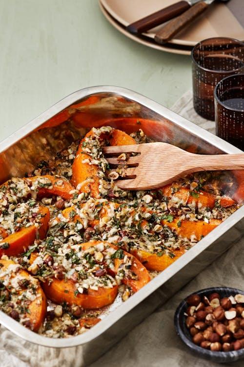 Calabaza asada con frutos secos y queso manchego