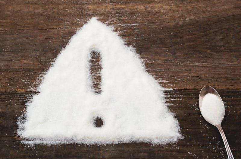 Signo de alerta hecho en azúcar