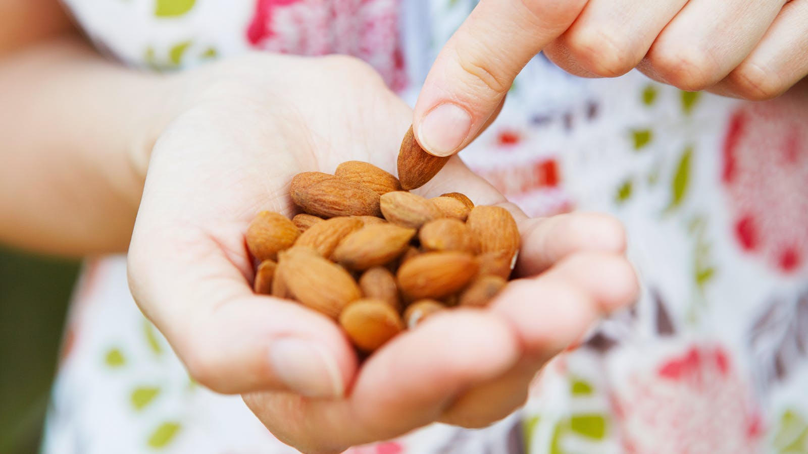 Woman snacking on nuts