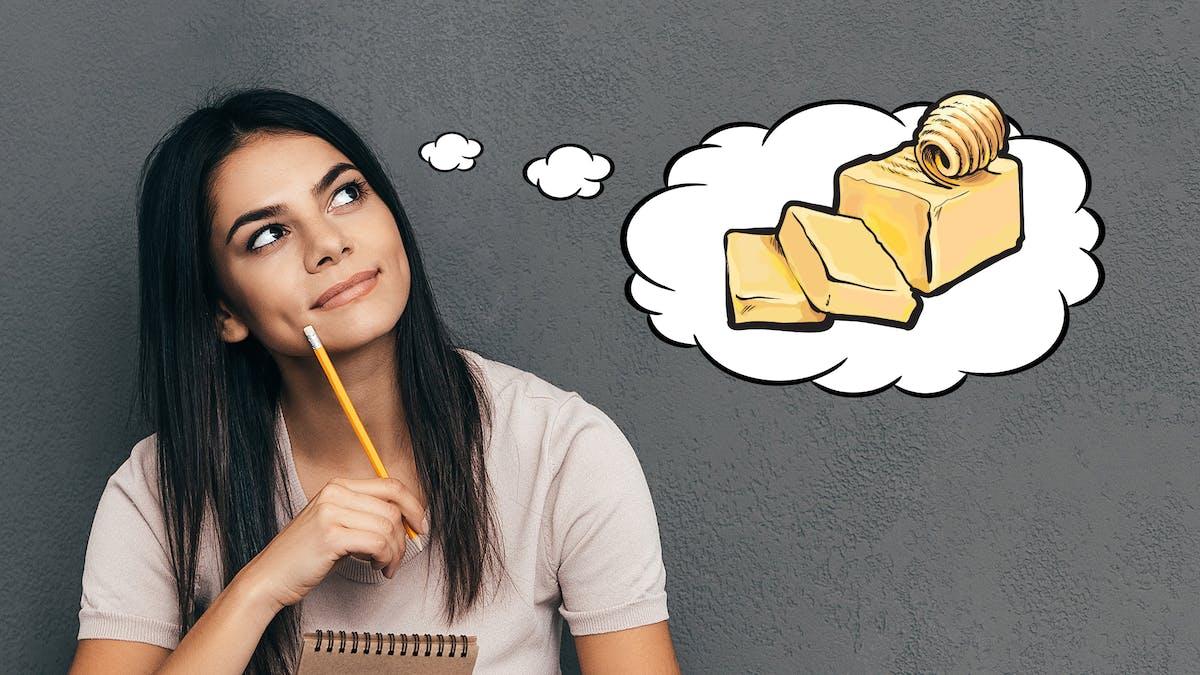 Chica pensando en mantequilla