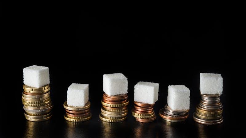 Azúcar sobre monedas
