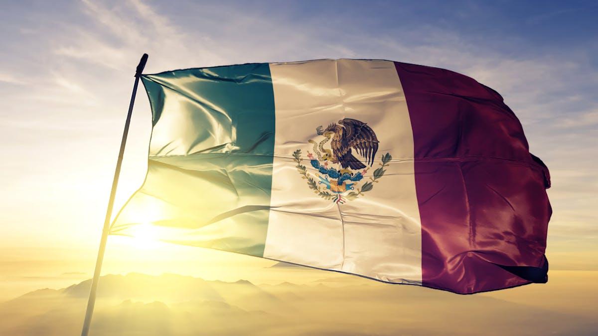 Mexico Mexican flag textile cloth fabric waving on the top sunrise mist fog