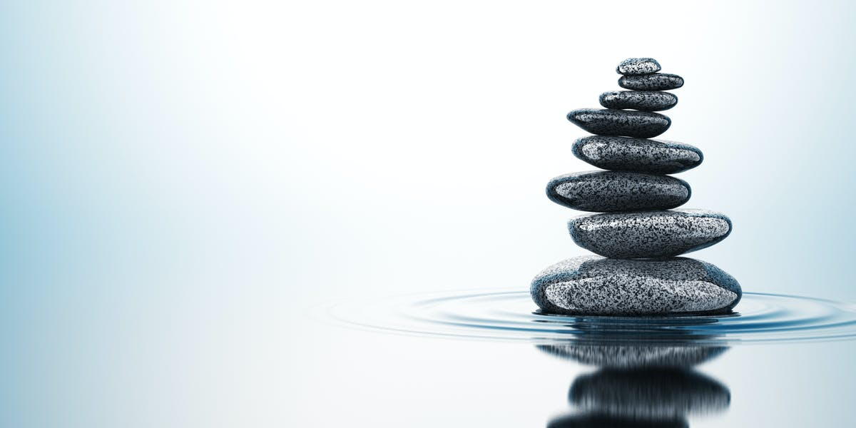 Balancing Stones On The Water