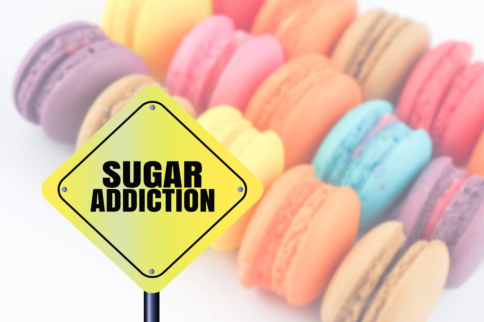 word sugar addiction blurred colorful sweet macaron