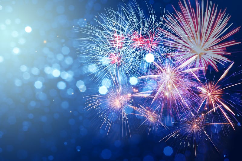 Abstract fireworks celebration on bokeh festive  light background