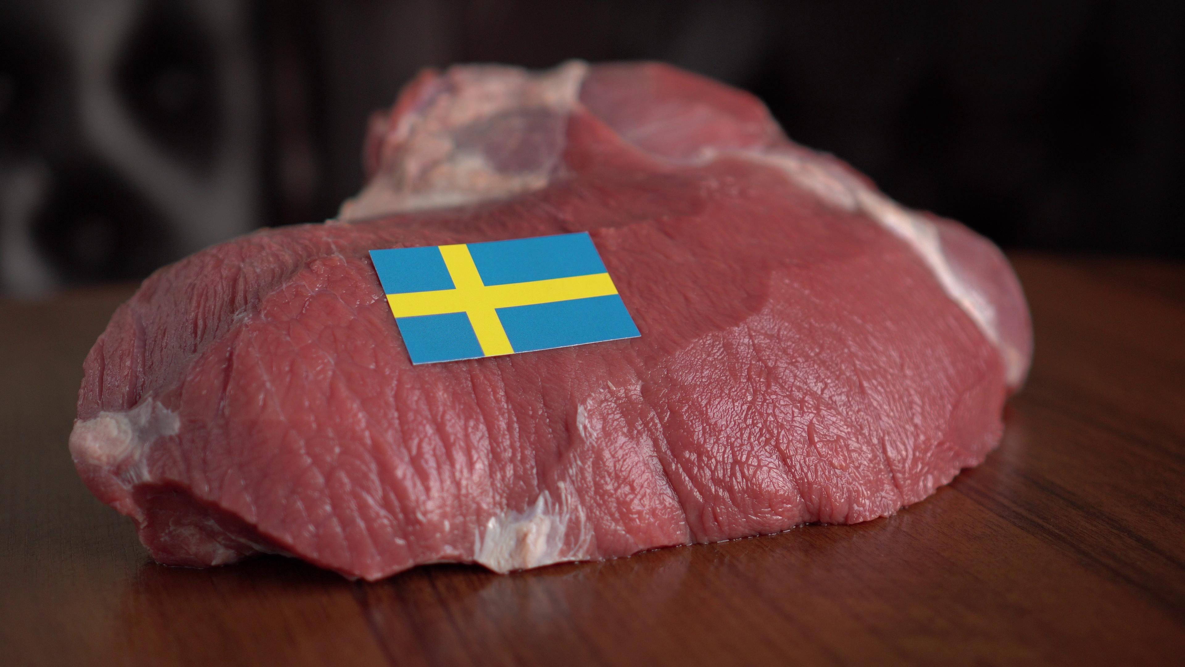 Raw meat and flag of Sweden