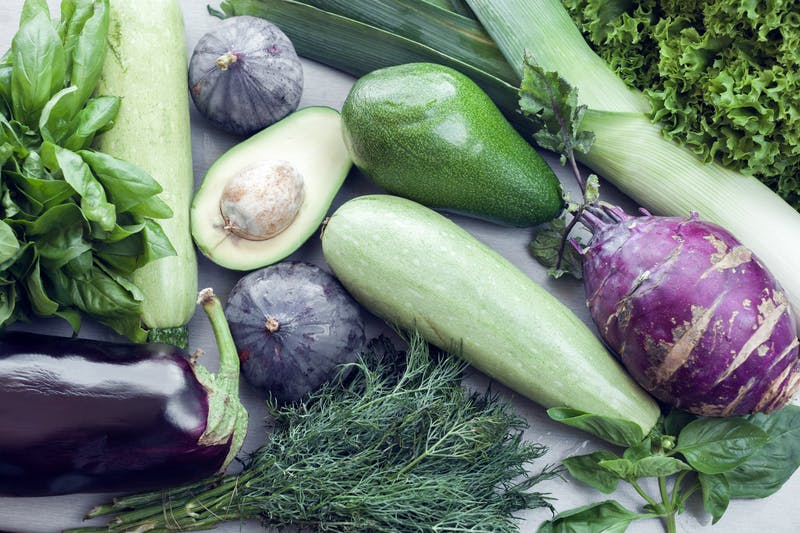 green and violet vegetables as background