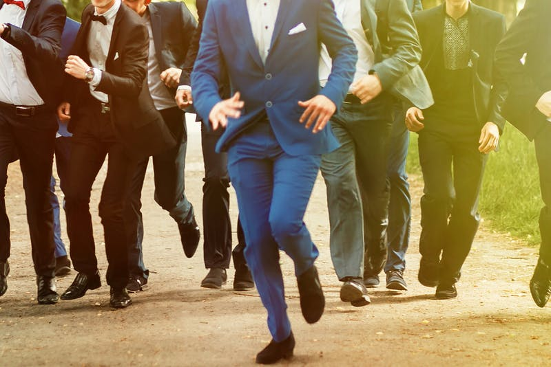 stylish confident men in suit running, reception at luxury wedding, rich graduation at school or university, business meeting