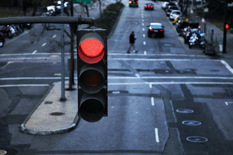 Red light hanging above a paved street in the city