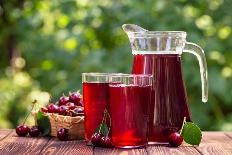 cherry juice in glasses and jug
