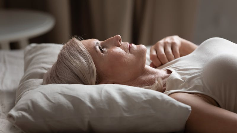 Sleepless mature woman lying in bed, suffering from insomnia
