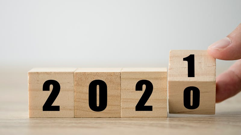 Hand flipping wooden blocks for change year  2020 to 2021 . New year and holiday concept.