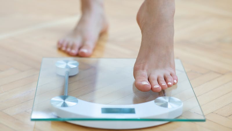 Female feet weighing scale