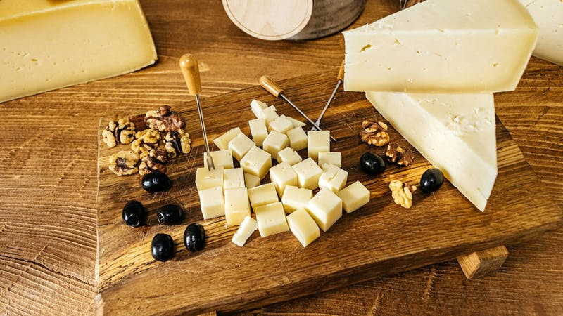 Composition of cheese cubes on a wooden table