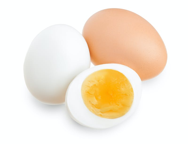 boiled egg and half isolated on white background