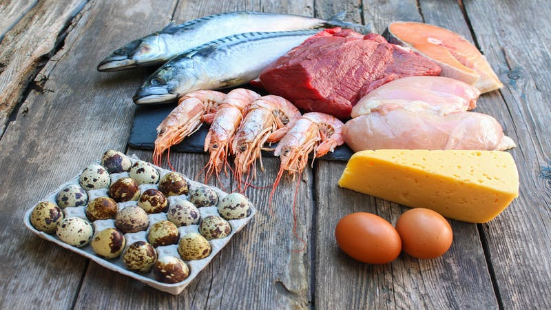 Healthy food of animal origin on old wooden background. Concept of proper nutrition.