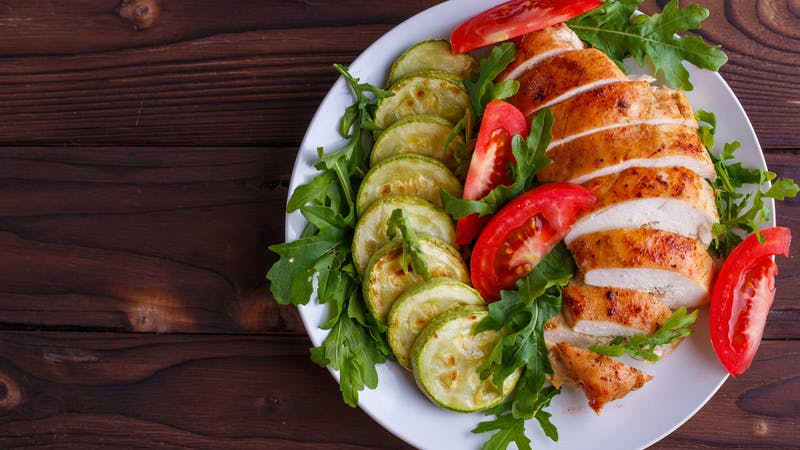 Healthy food, diet concept. Baked chicken breasts with zucchini