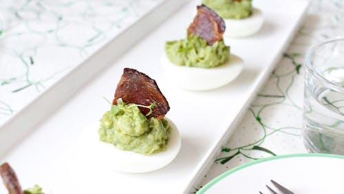 Keto avocado eggs with bacon sails