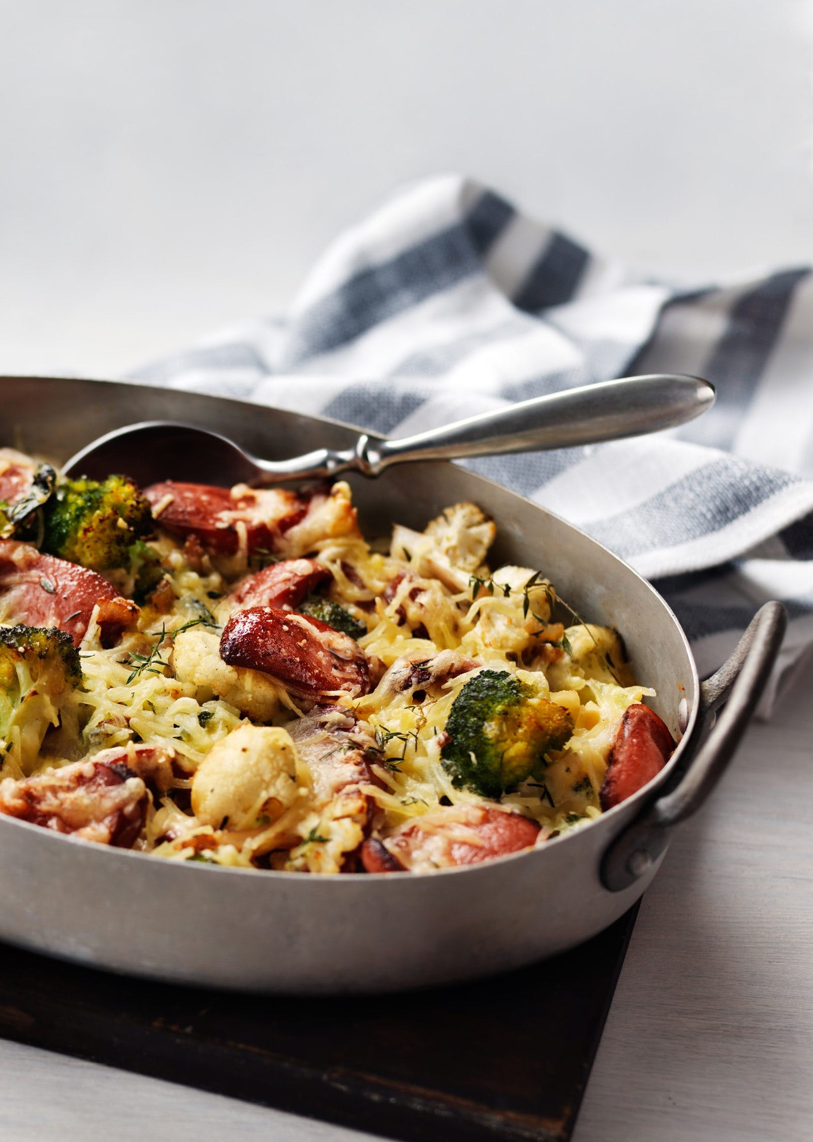 Broccoli and cauliflower gratin with sausage