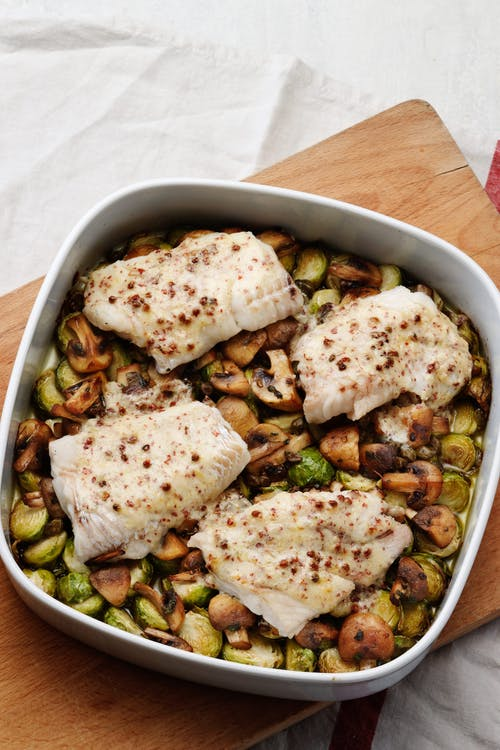 Butter-baked fish with Brussels sprouts and mushrooms