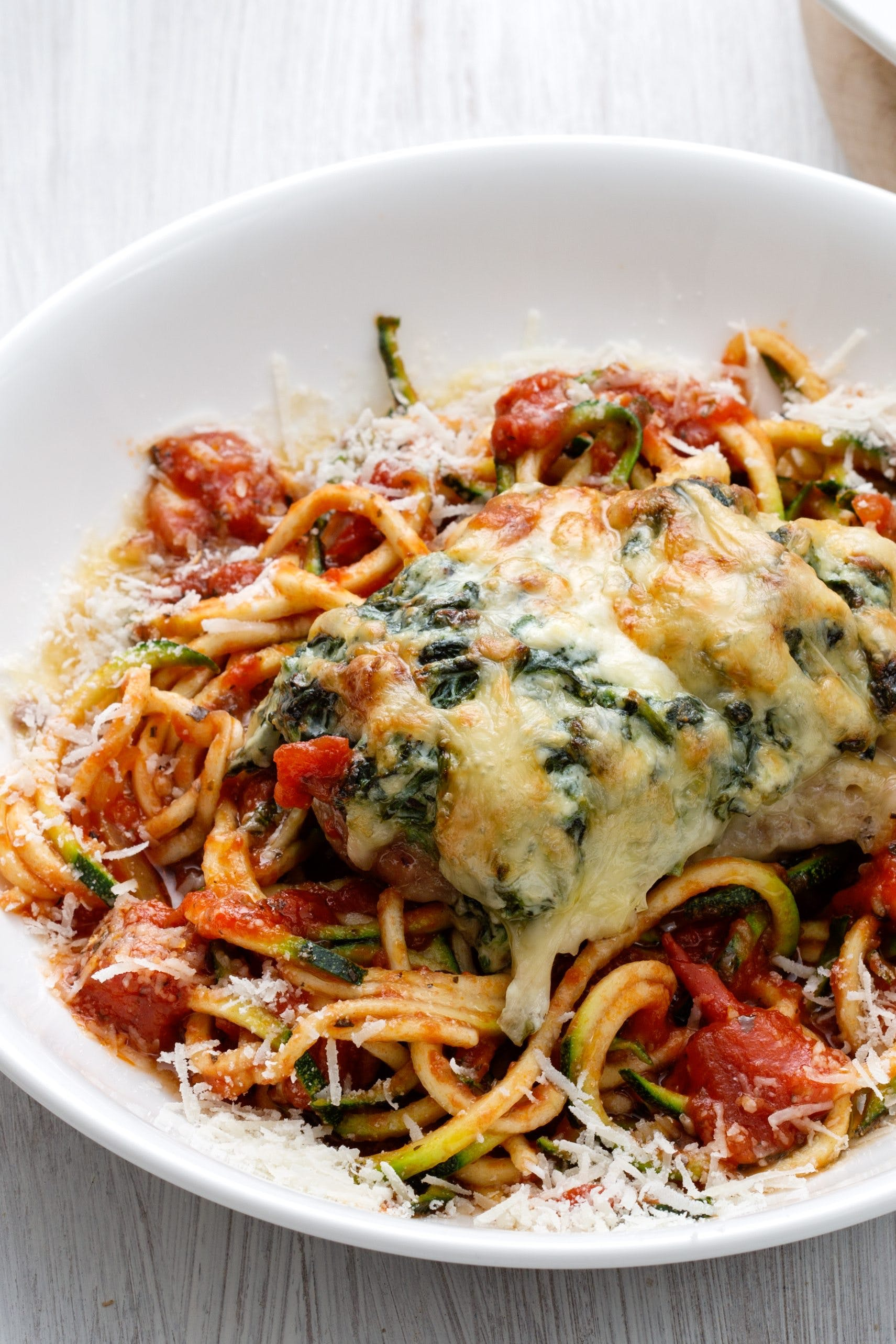 Stuffed chicken breast with zoodles and tomato sauce