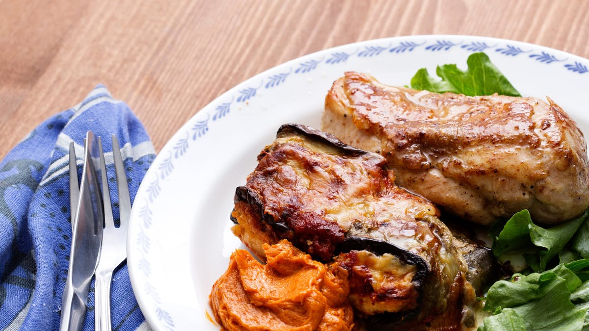 Eggplant roll-ups with chicken and tomato butter