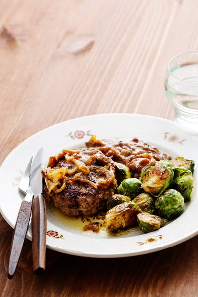 Hamburger patties with onions and Brussels sprouts<br />(Dinner)