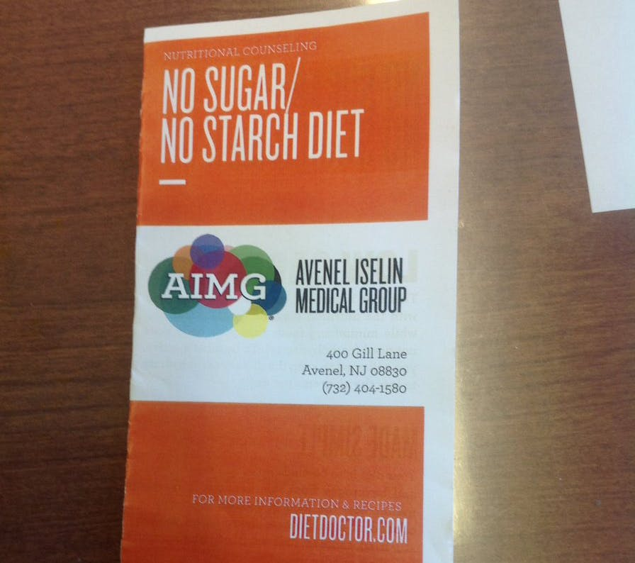 Physician Handing Out Diet Doctor-Inspired Low-Carb Pamphlets