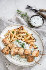 Chicken skewers with low-carb fries and spinach dip