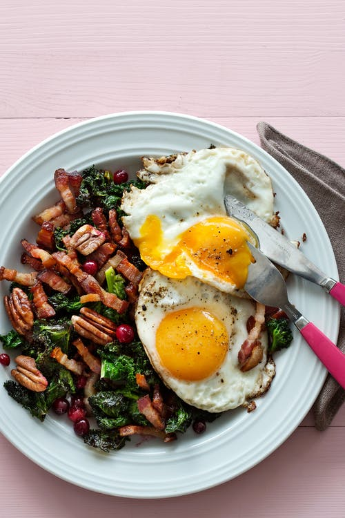 Keto fried eggs with kale and pork