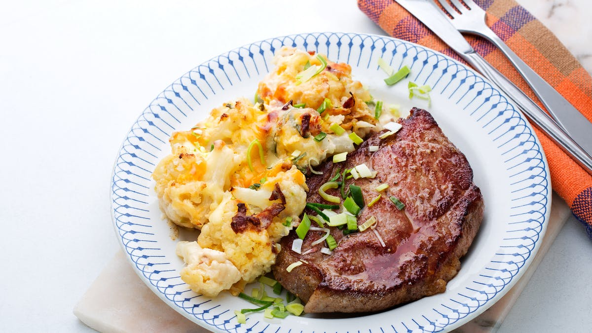 Pork shoulder chops with cauliflower au gratin