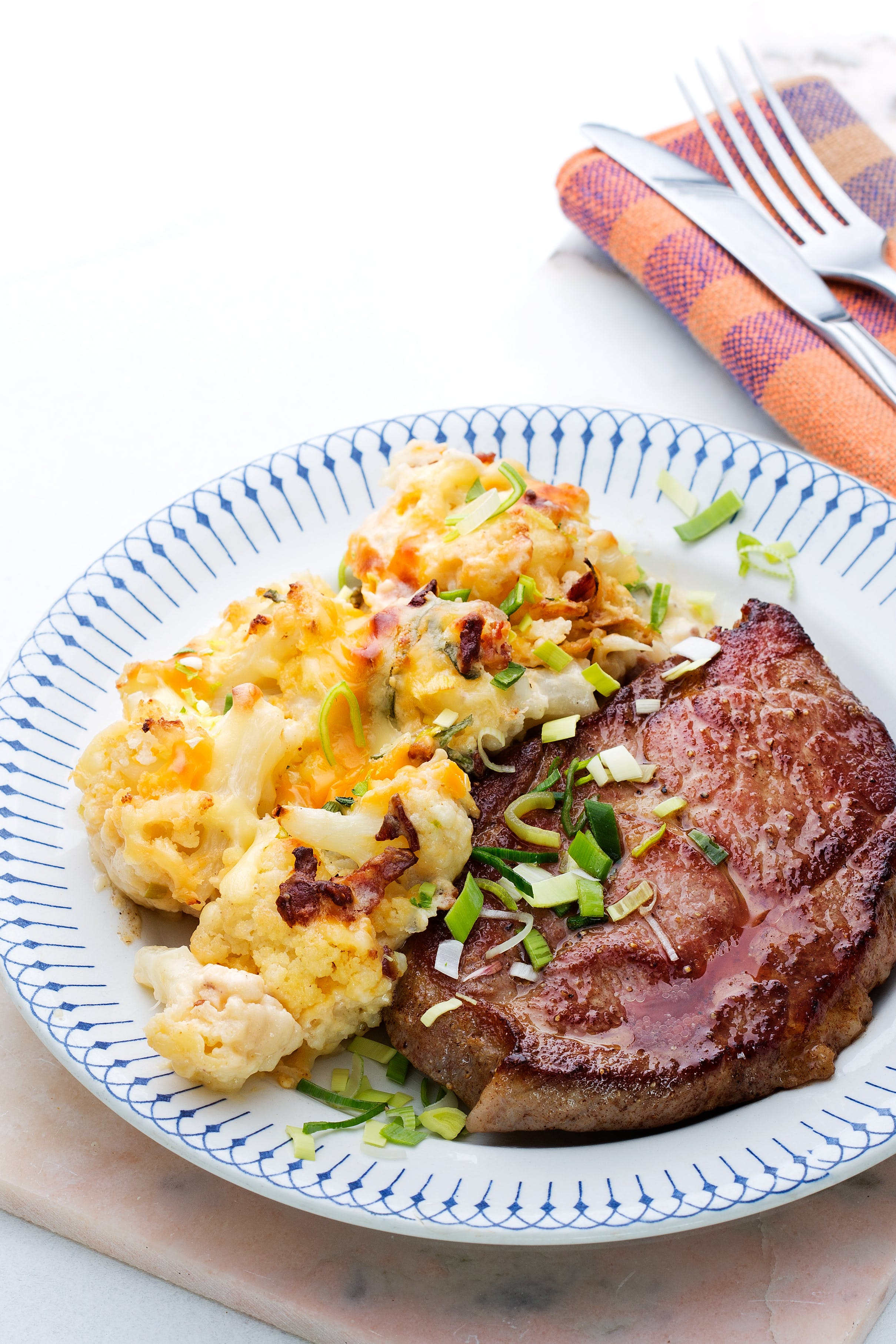 Pork shoulder chops with cauliflower au gratin