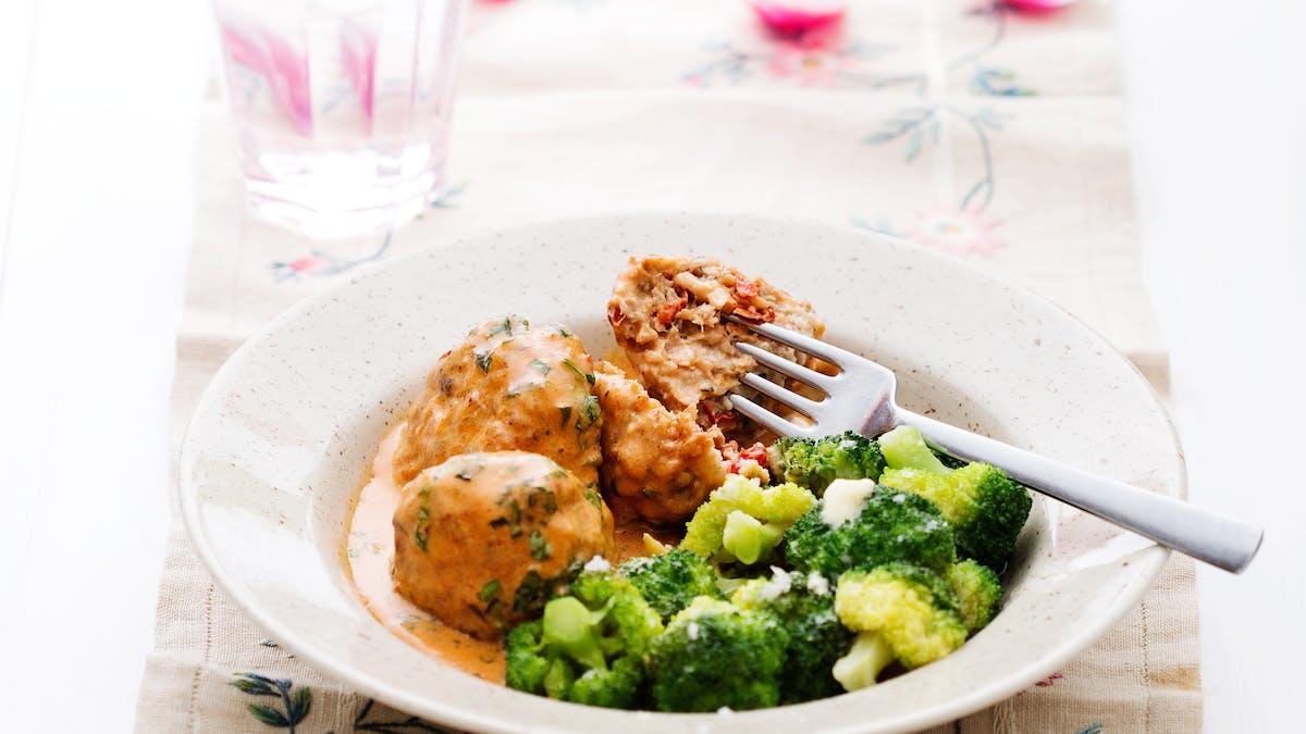 Italian chicken meatballs with cream sauce and broccoli