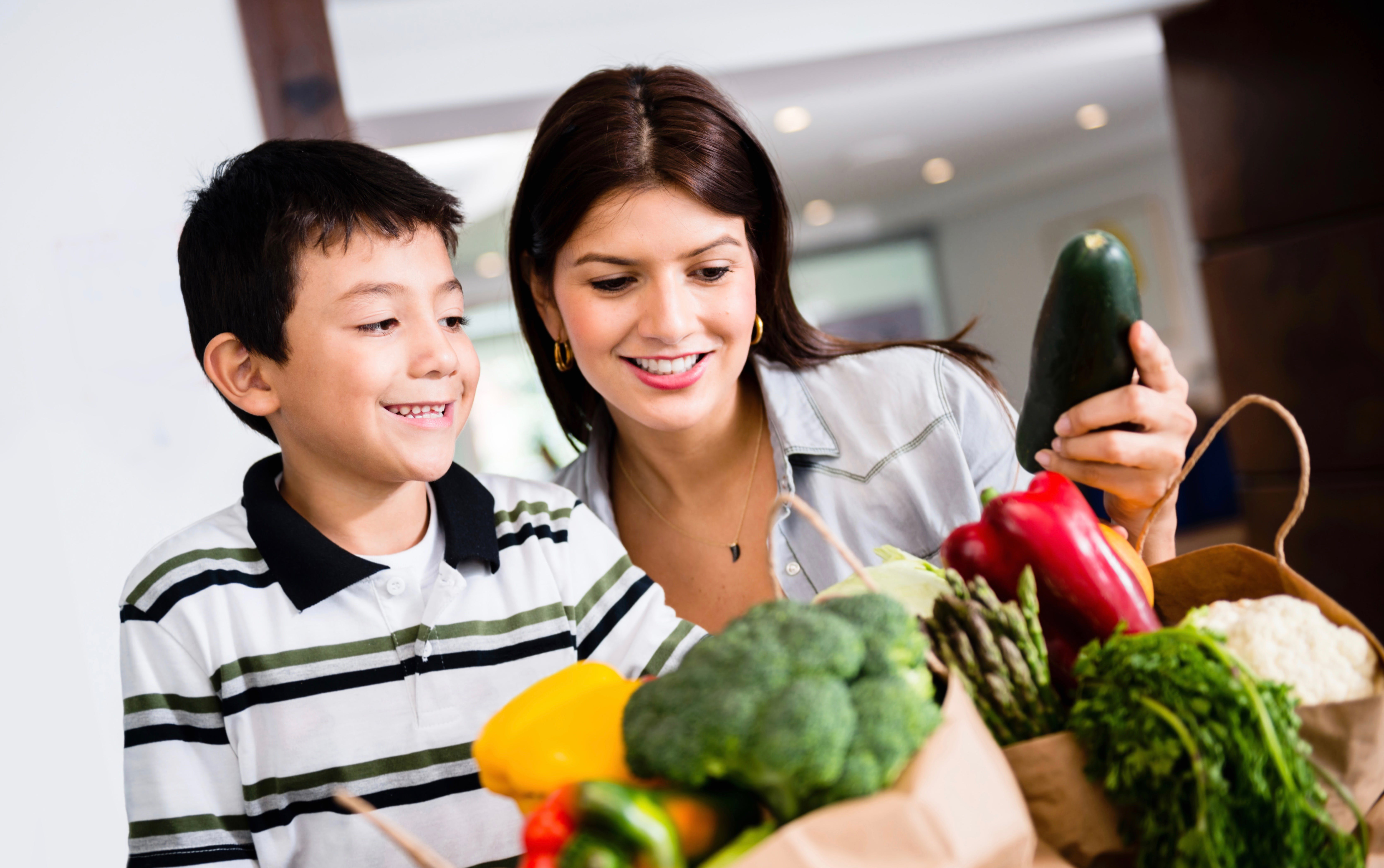 Mother and son organizing groceries