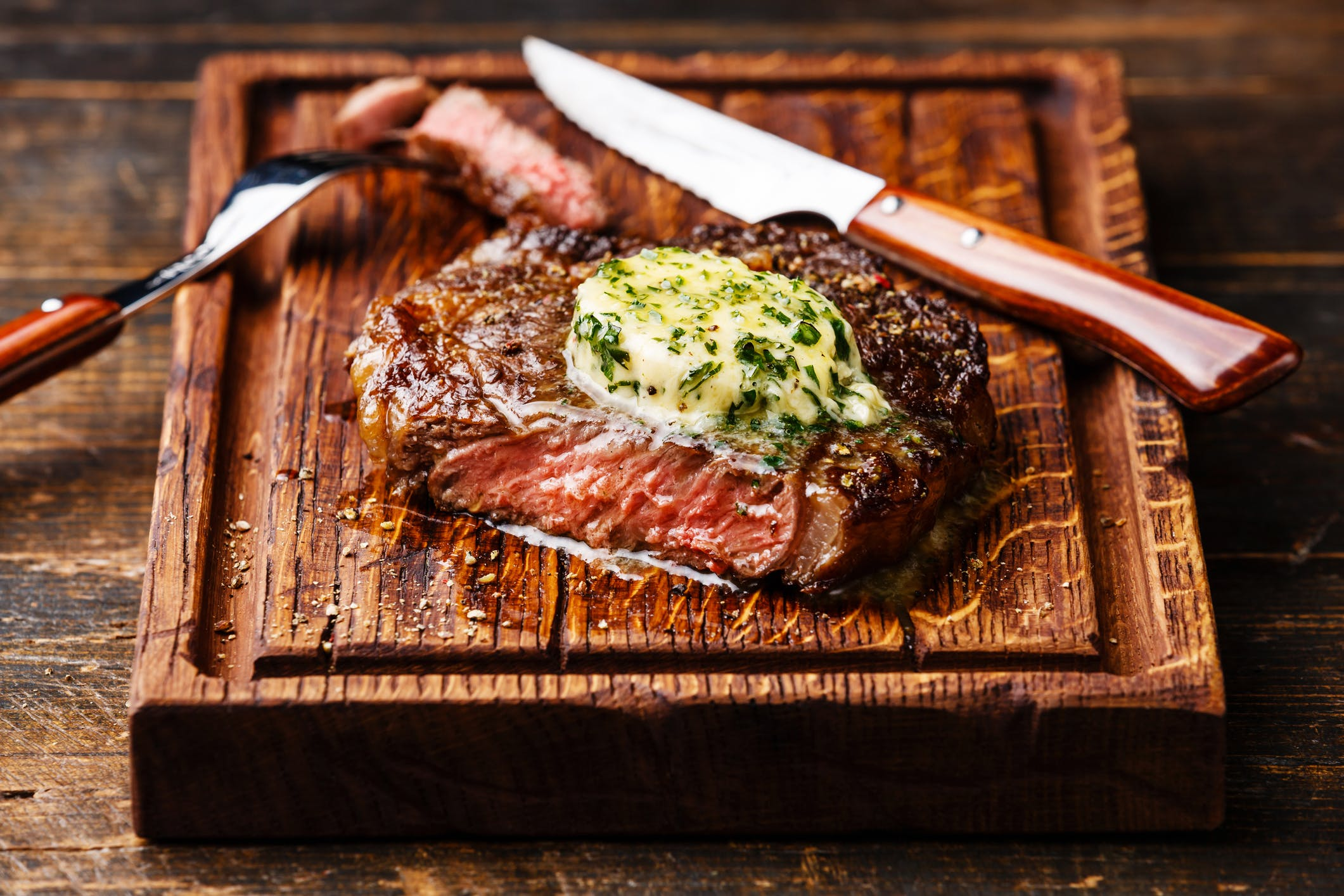 Grilled steak Ribeye with herb butter