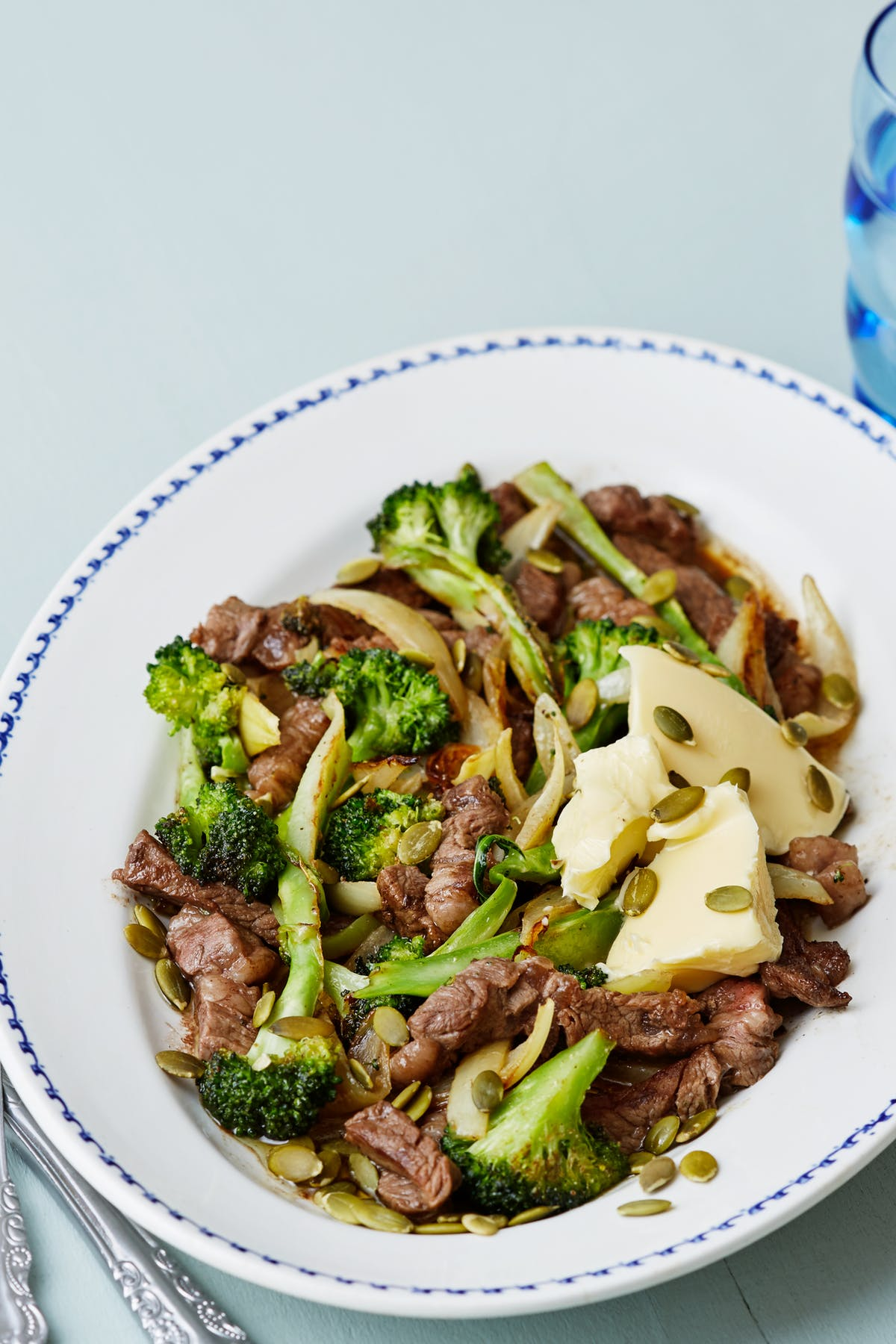 Steak and broccoli stir-fry with toasted pumpkin seeds