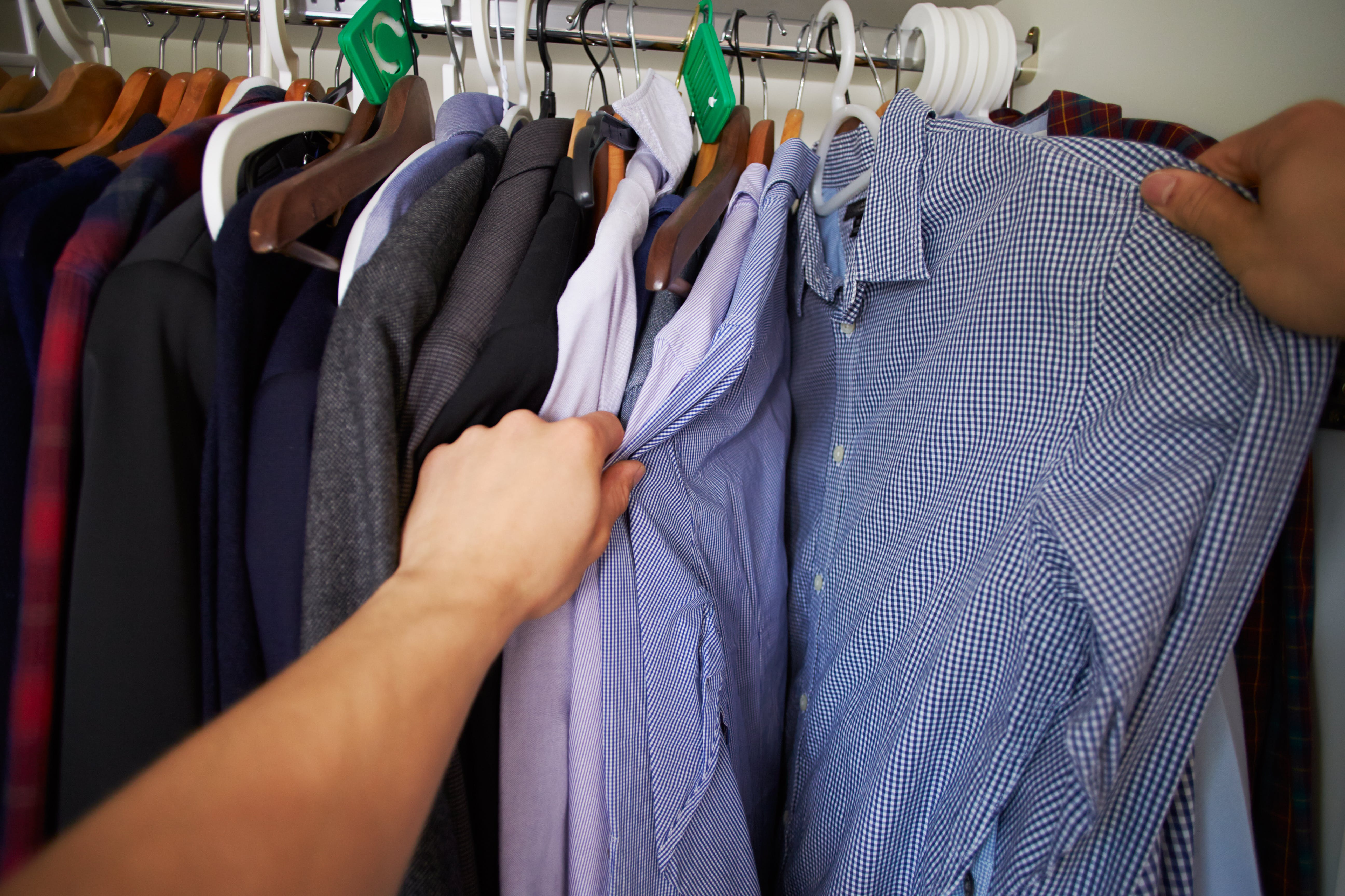 Point Of View Image Of Man Choosing Clothes From Wardrobe