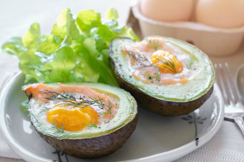 Baked smoked salmon, egg in avocado, ketogenic keto low carb diet food