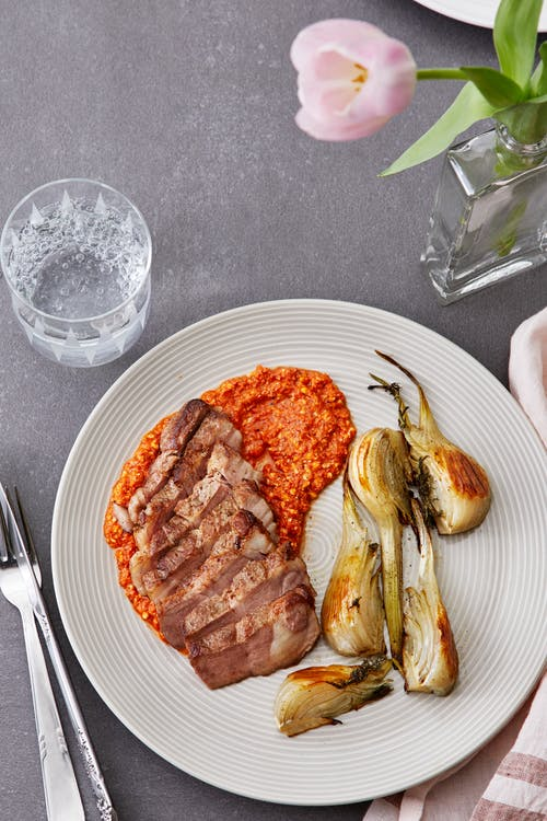 Pork shoulder with roasted fennel and Romesco sauce