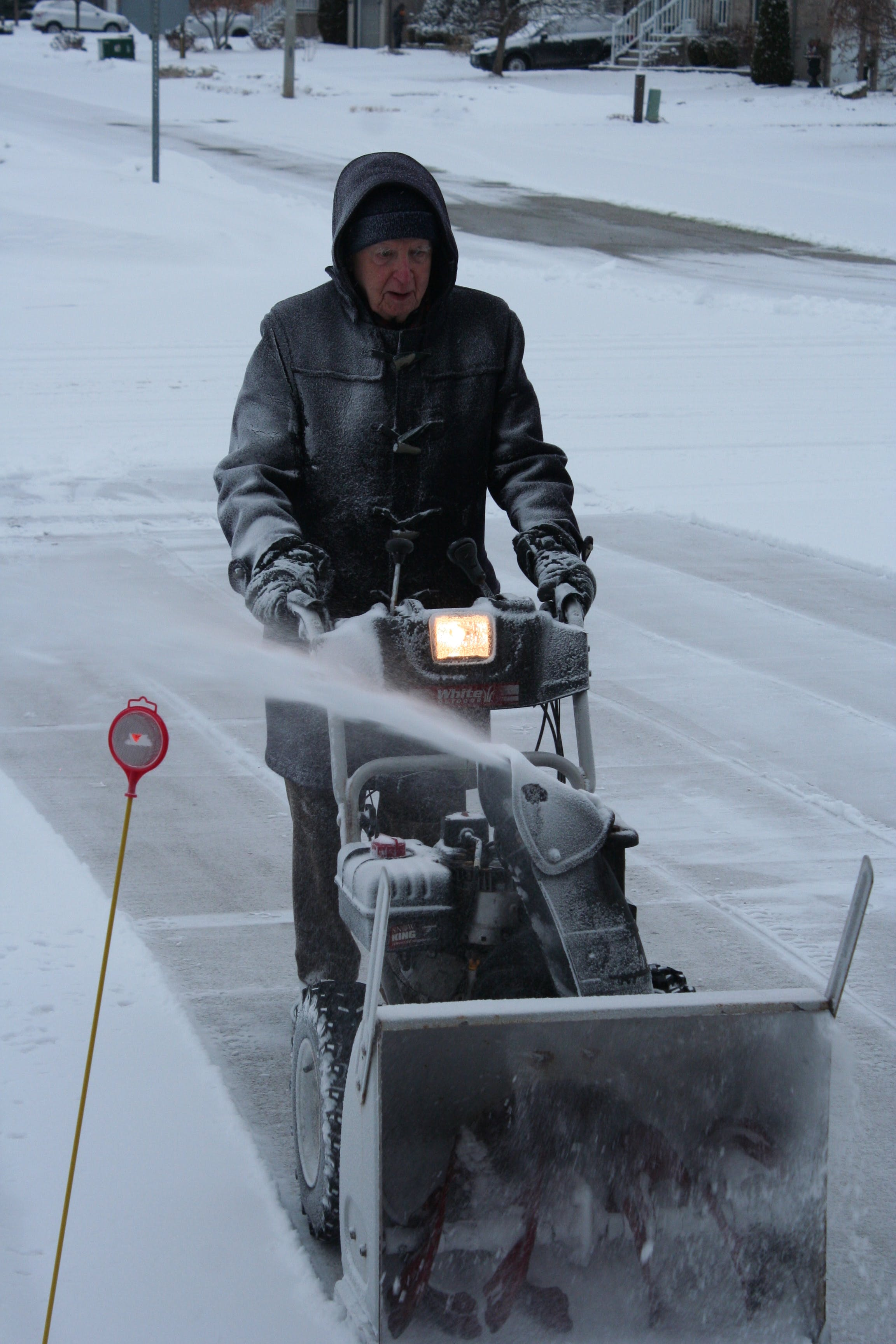 Dad snowblowing