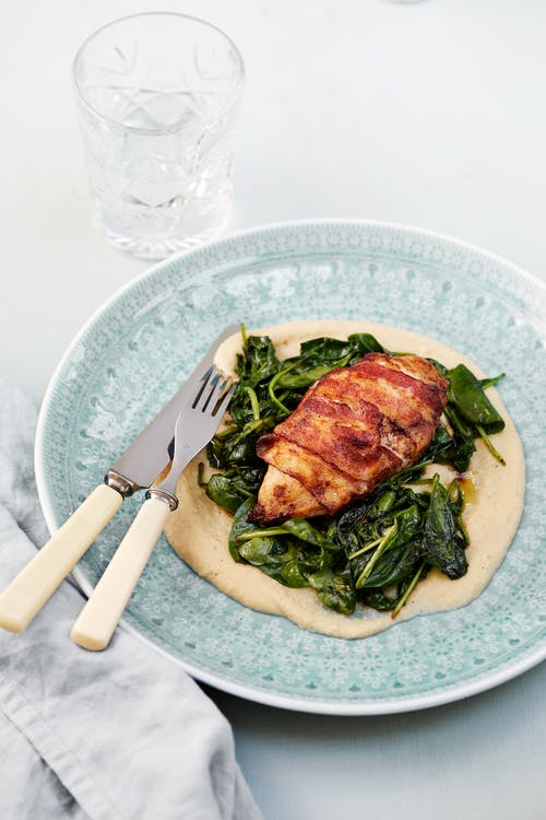 Bacon-wrapped chicken breast with cauliflower purée