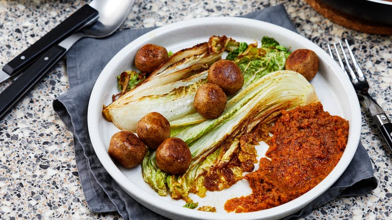 Vegetarian meatballs with fried Napa cabbage