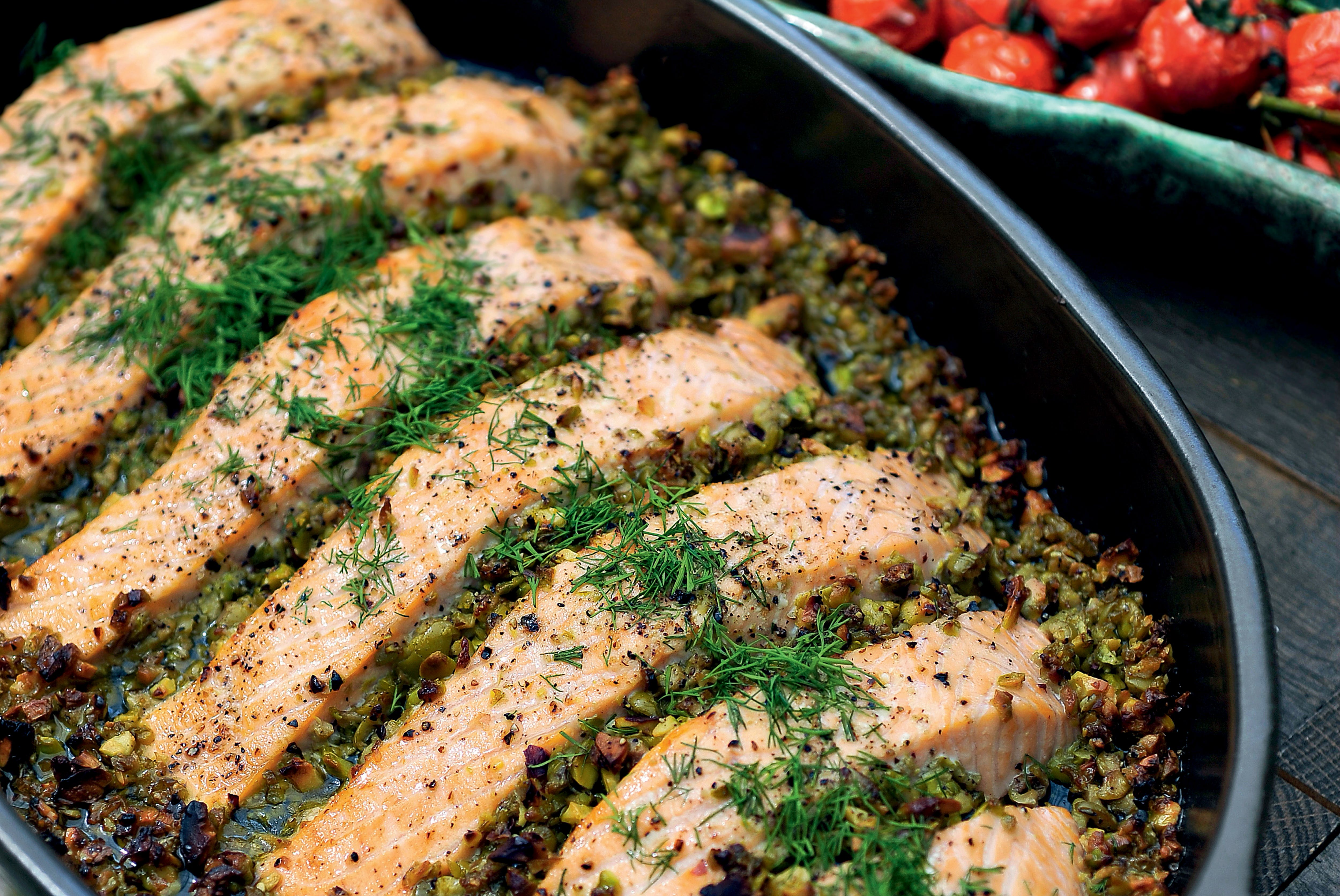 Salmon with olive-pistachio tapenade and tomatoes