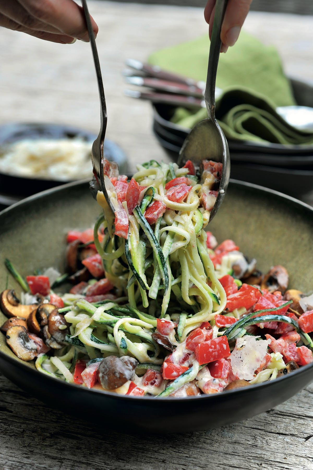 Zucchini noodles with tomatoes, mushrooms and Parmesan sauce