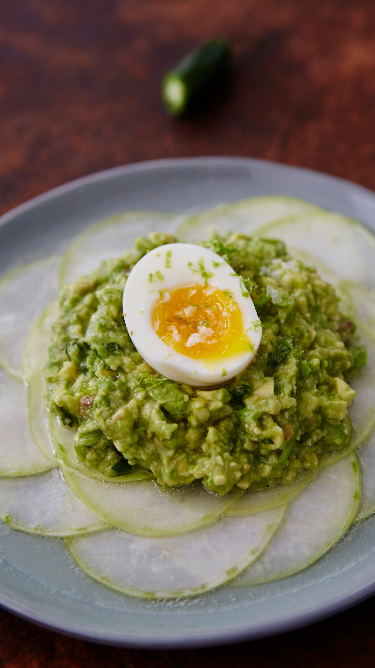 Shaved kohlrabi with smashed avocado, anchovies and soft-boiled eggs