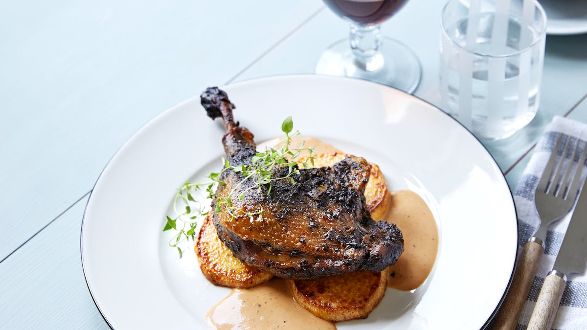 Duck confit with roasted rutabaga and balsamic sauce