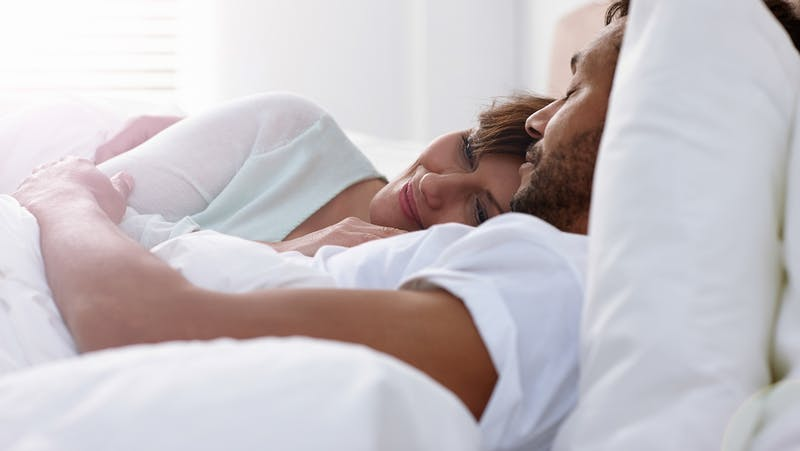 Relaxed couple in bed