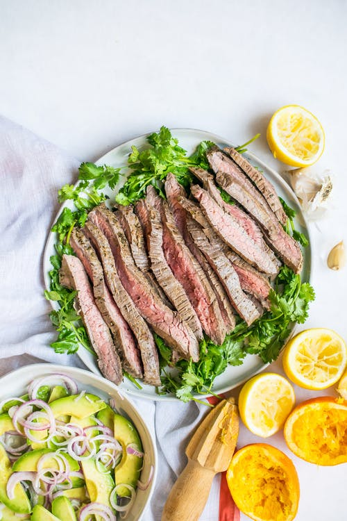 Carne asada with avocado salad