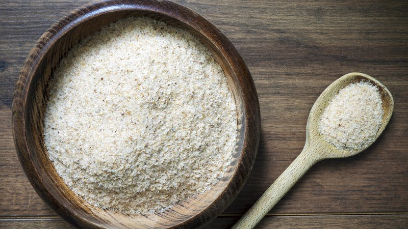 Psyllium husk (ispaghula) on a ladle and in a bowl